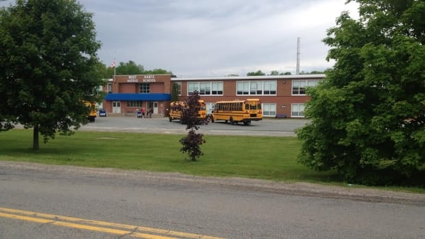 Students at West Hants Middle School and Brooklyn District Elementary School were kept after hours on Tuesday after reports in the area of a man carrying a gun.