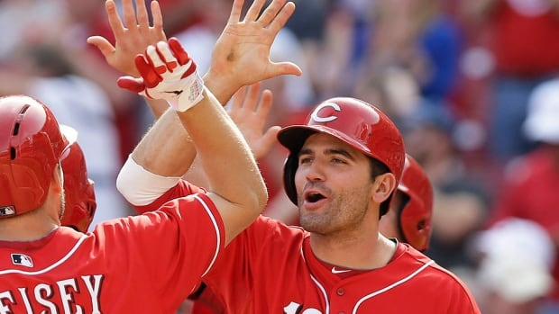 Reds first baseman Joey Votto, right, was hitting .257 with six home runs and 12 RBIs in 39 games before suffering a left quad injury that kept him out of the lineup nearly a month. He returned for Tuesday's game against the Los Angeles Dodgers.