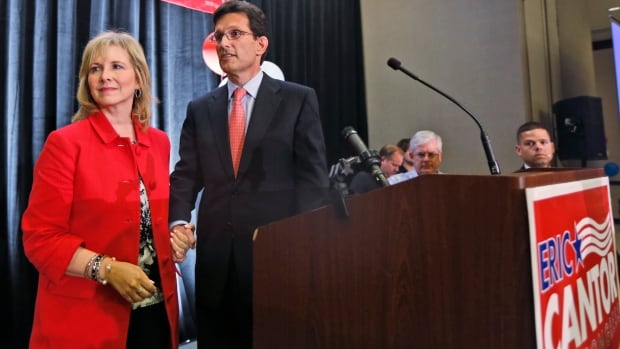 Republican House majority leader Eric Cantor leaves the stage with his wife after being defeated by a Tea Party candidate in Virginia's Republican primary on Tuesday.
