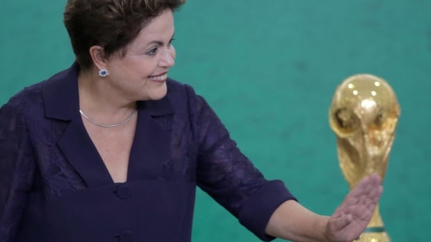 Brazilian President Dilma Rousseff defended the $11 billion invested into World Cup infrastructure throughout the country, and urged people living in host cities to give a 'warm welcome' to incoming tourists, in a televised address and on social media Tuesday.
