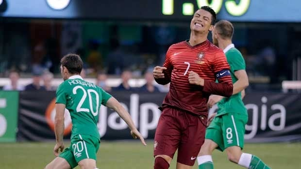 Cristiano Ronaldo reacts after missing a shot during Tuesday's friendly.