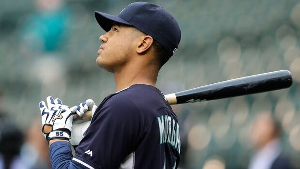 Outfielder Gareth Morgan holds a bat as he waits for his turn during Mariners batting practice on Tuesday in Seattle. He went in the cage after the Mariners announced they had signed the Canadian, the 74th overall selection in last week's amateur draft. Morgan, 18, reportedly agreed to a $2 million contract.
