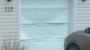 Damaged garage door on Penney Crescent