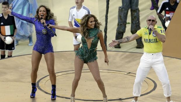 Pitbull, right, prevented the party from stopping during the opening ceremony of the World Cup.
