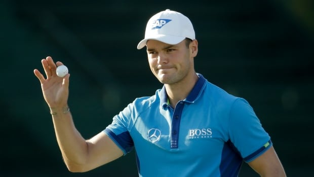 Martin Kaymer of Germany, waves after finishing the first round of the U.S. Open golf tournament in Pinehurst, N.C., on Thursday.