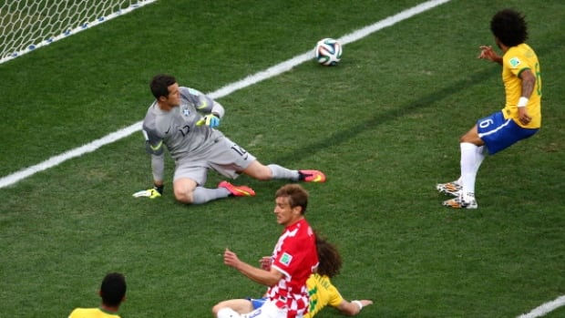 Marcelo, right, scores on his own goal in Brazil's opening World Cup win against Croatia.