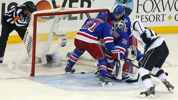 New York forward Derek Stepan gets ready to make a key play in Game 4, ensuring he didn't cover the puck with his glove.