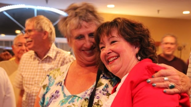 Kathryn McGarry shares an embrace with campaign volunteer Marnie McQuarie-Smith after being elected MPP for Cambridge.