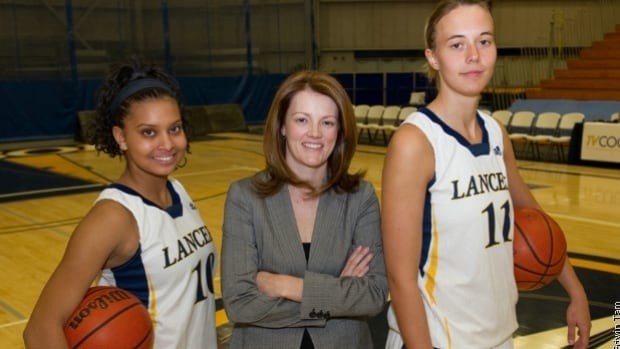 University of Windsor women's basketball coach Chantal Vallee, centre, has been named to the coaching staff of Brazil's Olympic women's basketball team.