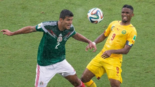 Mexico's Francisco Javier Rodriguez, left, goes up for a header against Samuel Eto'o of Cameroon.