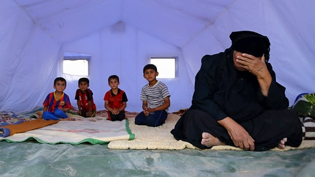 An Iraqi family, who fled from the violence in Mosul when ISIS fighters showed up last week, take refuge in a tent camp on the outskirts of Arbil in Iraq's Kurdistan region. The Islamist group known as ISIS is about an hour's drive from Baghdad.