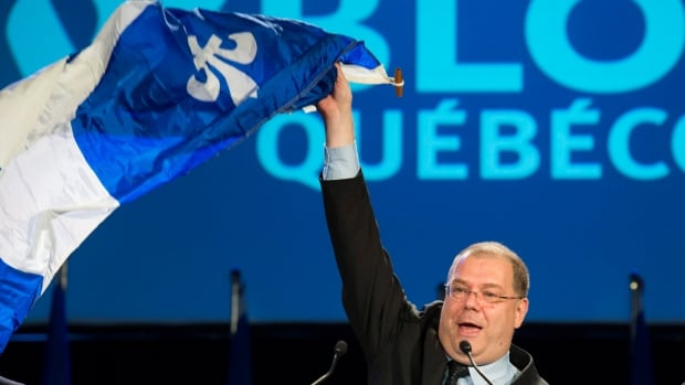"Mario Beaulieu waved a Quebec flag during his speech in Montreal Saturday, June 14, 2014 after being named new leader of the Bloc Québécois. Several members of the Bloc quit after Beaulieu won the party leadership, with one even calling Beaulieu a ""clown."""