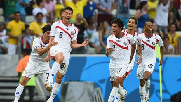 Oscar Duarte of Costa Rica, second left, celebrates his goal against Uruguay.