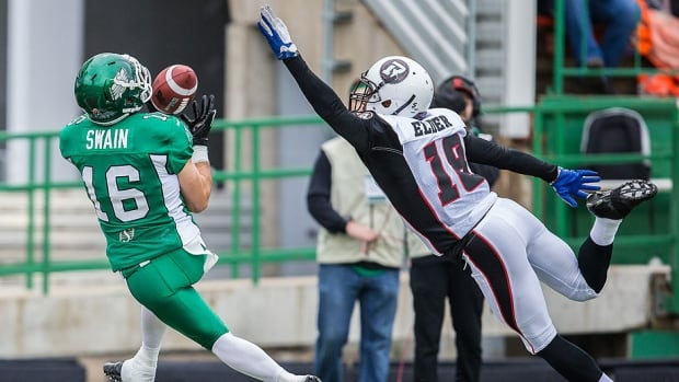 Rookie Roughriders slotback Brett Swain hauls in a touchdown pass behind the Redblacks' Eddie Elder in the first half of Saturday's CFL pre-season game in Regina. Saskatchewan scored 21 unanswered points for a 21-17 win.