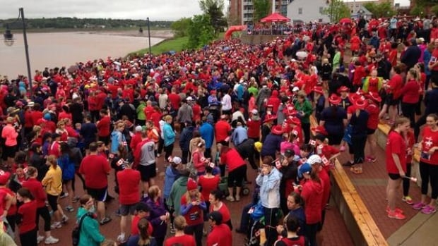 Thousands of runners dressed in red gathered in Moncton Sunday in memory of three slain RCMP officers.