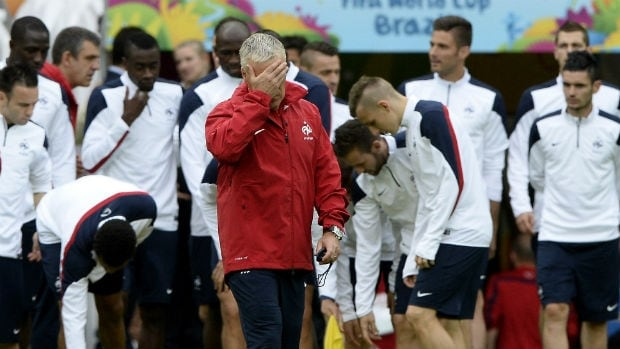 France manager Didier Deschamps, foreground, covering his face during training. Presumably, so the drone doesn't recognize him.