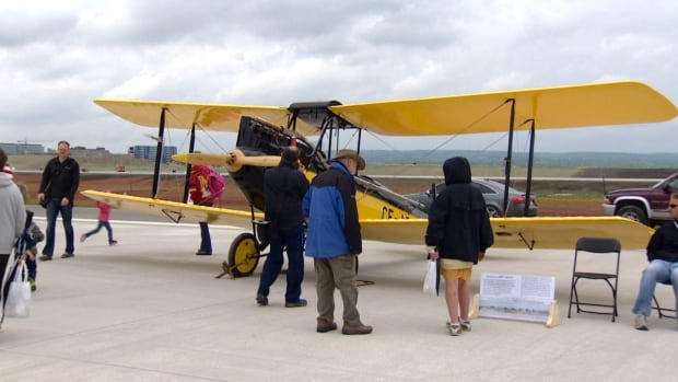 People got a chance to roam the new airport runway today and take in the sights, such as these vintage planes.