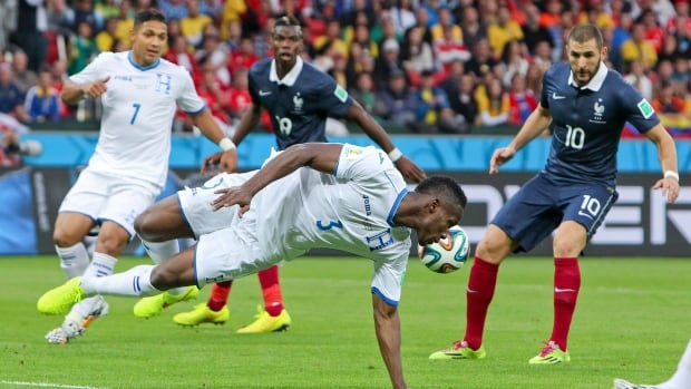 Honduras' Maynor Figueroa (3) tries to block the ball during the group E World Cup soccer match between France and Honduras in Porto Alegre, Brazil, on Sunday. France won 3-0.