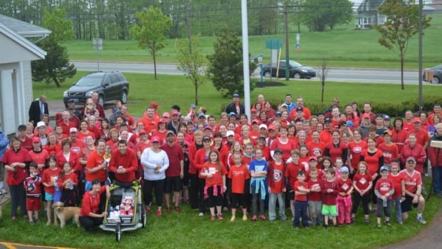 About 250 people took part in a three-kilometre run to raise money for the families of fallen RCMP officers.