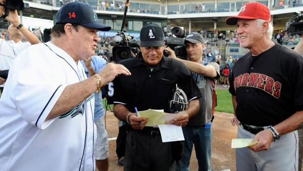 Pete Rose, left, and Lancaster Barnstormers manager Butch Hobson talk at home plate before Monday's Atlantic League game in Bridgeport, Conn. Rose, banned from Major League Baseball, returned to the dugout for one day to manage the independent minor-league Bridgeport Bluefish.
