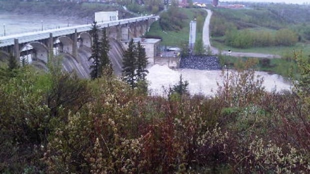 The city continues to release water from the Glenmore Reservoir, although Calgary is not expecting any significant rainfall this week.