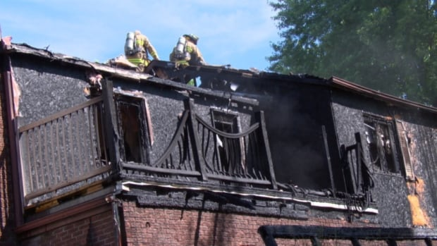 Firefighters work to put out the blaze at 5 Bell Street in Stittsville after it spread to the home's attic.