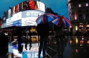 BRITAIN/Umbrellas in Piccadilly Square