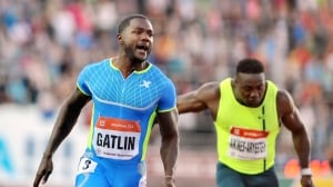 Justin Gatlin, left, reacts as he wins the men's 100-metre race at the Golden Spike Athletic meeting in Ostrava, Czech Republic.