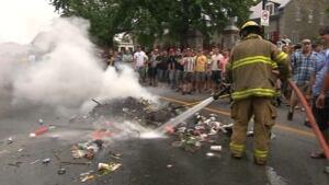Firefighter douses bonfire