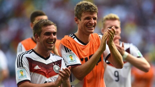 Thomas Müller of Germany, right, acknowledges the fans after scoring a hat trick against Portugal in Salvador, Brazil on Monday.