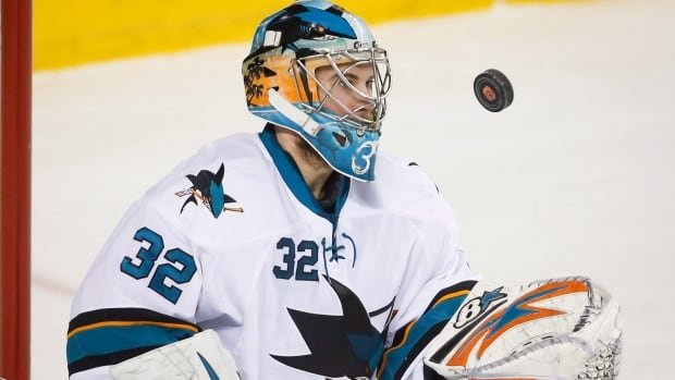 San Jose Sharks goalie Alex Stalock juggles the puck during first period NHL hockey action against Calgary on Jan. 30.