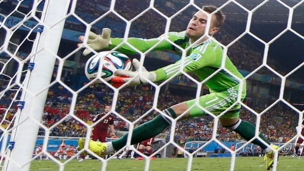 Russia's Igor Akinfeev fumbles the ball to concede a goal to South Korea's Lee Keun-ho during their FIFA World Cup Group H match at the Pantanal arena in Cuiaba.