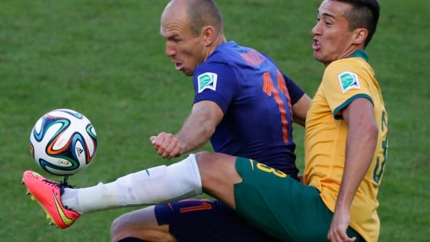 Arjen Robben and the Netherlands survived a scare against Australia at the FIFA World Cup in Brazil.