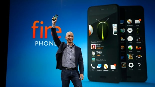 Amazon CEO Jeff Bezos holds the Amazon Fire phone at the launch event Wednesday in Seattle. It ships in July in the U.S., but plans for Canada have not yet been revealed.