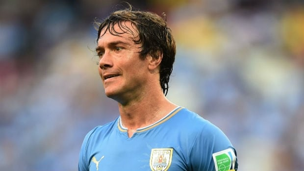 Uruguay captain Diego Lugano has been ruled out of the World Cup match against England on Thursday with a knee injury.
