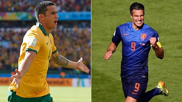 Tim Cahill, left is now a contender for the best goal at the 2014 FIFA World Cup after scoring a wonder volley against the Netherlands. But is it better than Robin van Persie's rainbow header?