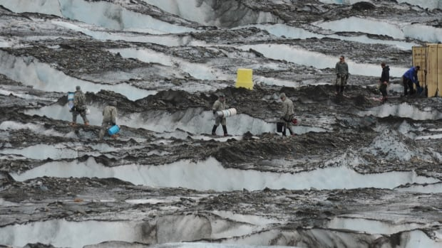 The Joint Task Force-Alaska Team from Joint Base Elmendorf-Richardson and Fort Wainwright recover debris on Colony Glacier near Anchorage, Alaska, in July 2012. The remains of about a third of the 52 U.S. service members who died in the crash outside Anchorage in 1952 have now been identified.