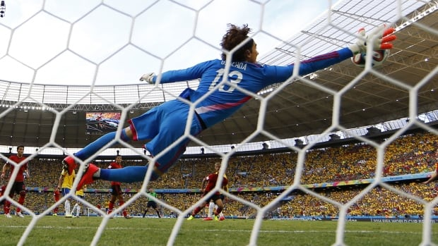 Mexican goalie Guillermo Ochoa's save in the match against Brazil is being compared to English keeper Gordan Banks's stop on Pele.