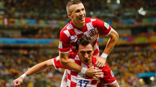Croatia's Mario Mandzukic (bottom) celebrates after scoring a goal with teammate Ivan Perisic during Wednesday's match at the Amazonia arena in Manaus, Brazil.