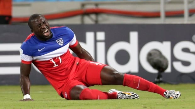 United States striker Jozy Altidore grimaces after pulling up injured during the group G World Cup soccer match between Ghana and the United States at the Arena das Dunas in Natal on June 16.