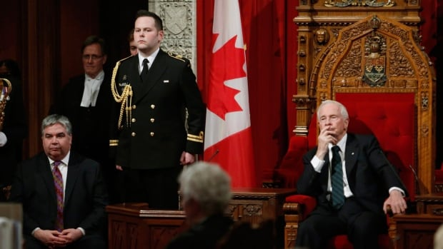 Gov. Gen. David Johnston, right, oversees a ceremony giving royal assent to government legislation in the Senate with Peter Van Loan, Leader of the Government.