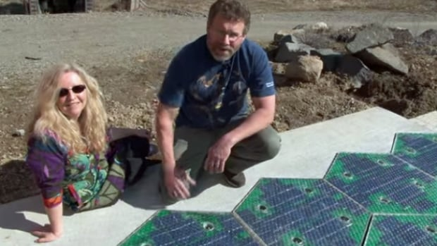 According to an Indiegogo campaign video, the hexagonal, solar paving tiles were developed by an Idaho couple named Scott and Julie Brusaw, who built their initial prototypes using funding from the United States' Federal Highway Administration. The tiles are said to contain heating elements that will melt snow on contact, eliminating the need for snow-clearing.  They also contain light-emitting diodes that the couple says could be programmed to display lane boundaries, cross-walks and other traffic markings.