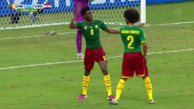 Cameroon's Benoît Assou-Ekotto, left, thought that headbutting an opponent was too conventional. So he headbutted his teammater.