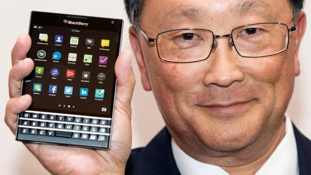 BlackBerry CEO John Chen shows off the Passport 'phablet,' a cross between a phone and a tablet.