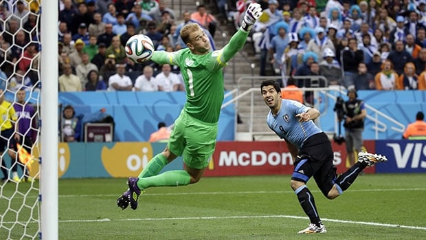 Uruguay's Luis Suarez, right, watches his first-half header sail past England goalkeeper Joe Hart.