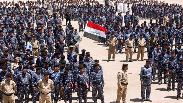 Volunteers wearing police uniforms line up in Najaf to join the Iraqi security forces in the fight against the predominantly Sunni militants that have stormed in from neighbouring Syria. Tens of thousands of mostly Shia men have signed up, but they still have to be trained.