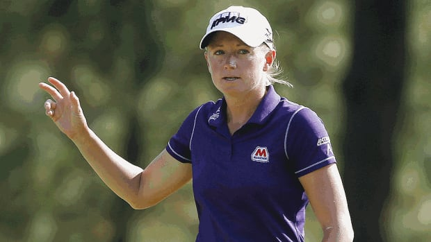 Stacy Lewis of the United States makes birdie on the 14th hole during the first round of the 69th U.S. Women's Open at Pinehurst Resort & Country Club in North Carolina. She shot a three-under 67 and has a one-shot lead over Michelle Wie with play suspended in the first round.