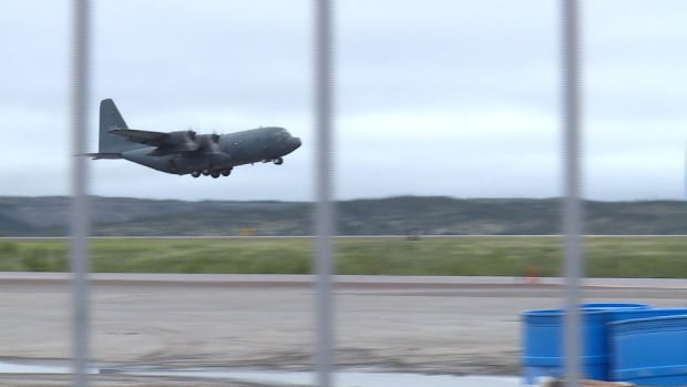 A Canadian Forces Hercules C-130 from Winnipeg takes off from Inuvik's airport Thursday evening to help in a search for two missing boaters from Aklavik, N.W.T.