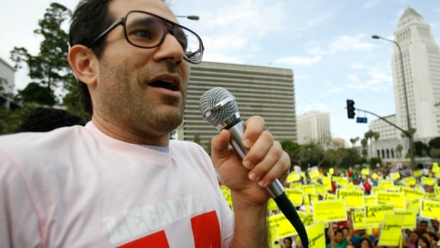 American Apparel owner Dov Charney speaks during a march for immigrant rights in 2009. He is mounting a fight for control of the retailer and has bought a stake totalling nearly 43 per cent.