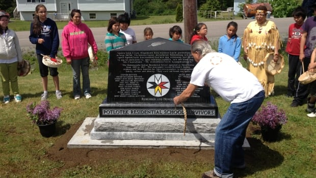 A monument engraved with 24 names of residential school survivors was unveiled at Potlotek school.